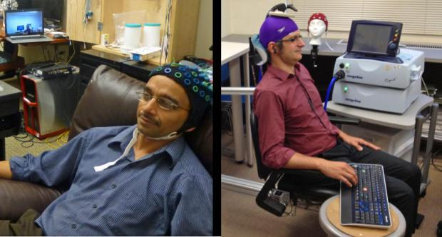 "University of Washington University of Washington researcher Rajesh Rao, left, plays a computer game with his mind. Across campus, researcher Andrea Stocco, right, wears a magnetic stimulation coil over the left motor cortex region of his brain. Stocco's right index finger moved involuntarily to hit the ""fire"" button as part of the first human brain-to-brain interface demonstration. (Credit: Image courtesy of University of Washington)"