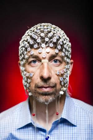 Electrical and computer engineering professor Barry Van Veen wears an electrode net used to monitor brain activity via EEG signals. His research with psychiatry professor and neuroscientist Giulio Tononi could help untangle what happens in the brain during sleep and dreaming. Credit Nick Berard.